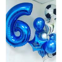 Композиция из воздушных шариков на шесть лет с футбольными мячами и звездами