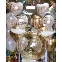 Композиция из гелевых шаров на свадьбу с большим шаром с конфетти и шарами с перьями